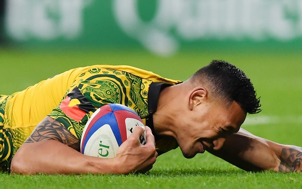 Australia's full-back Israel Folau scores a try during the international rugby union test match between England and Australia at Twickenham stadium.