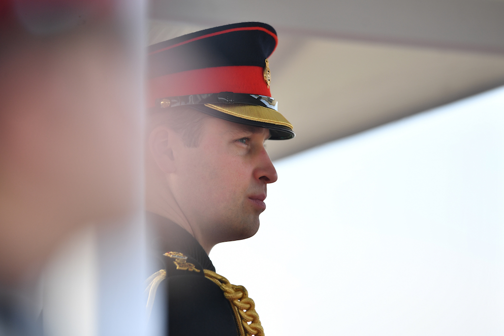 File: Britain's Prince William, Duke of Cambridge representing Britain's Queen Elizabeth II inspects the graduating officer cadets during the Sovereign's Parade at the Royal Military Academy, Sandhurst, southwest of London on December 14, 2018.