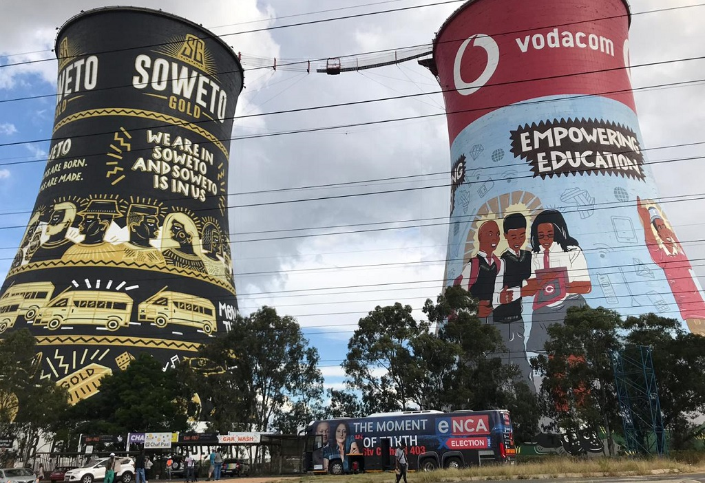 eNCA Election Bus in front of the Soweto Towers