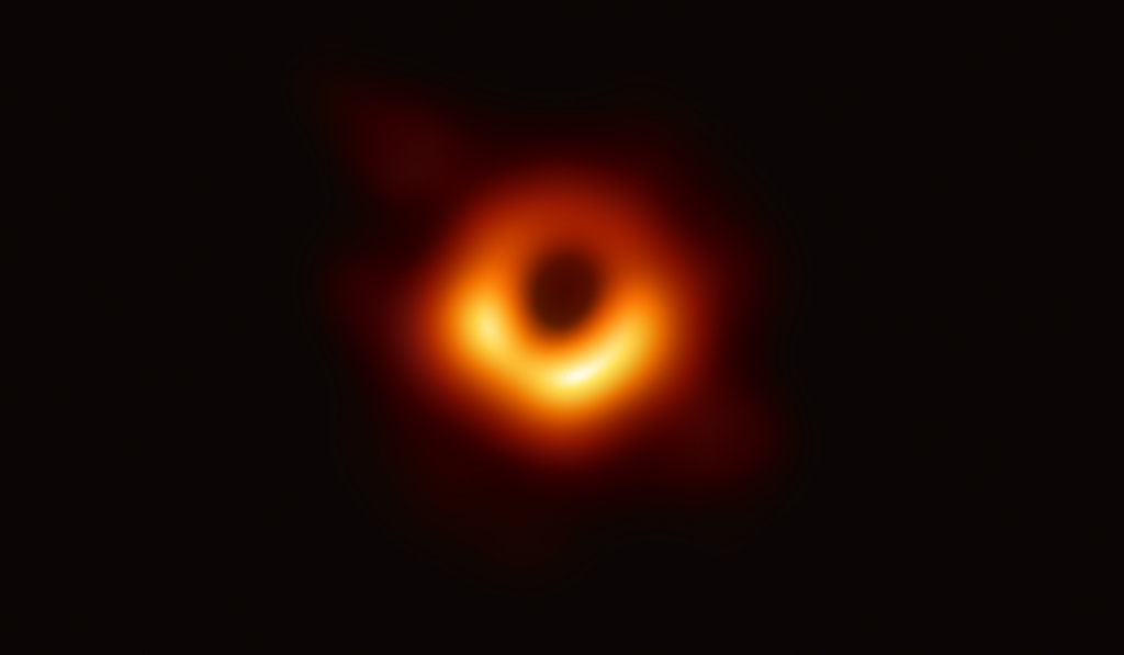 The image of a dark core encircled by a flame-orange halo of white-hot gas and plasma looks like any number of artists' renderings over the last 30 years.