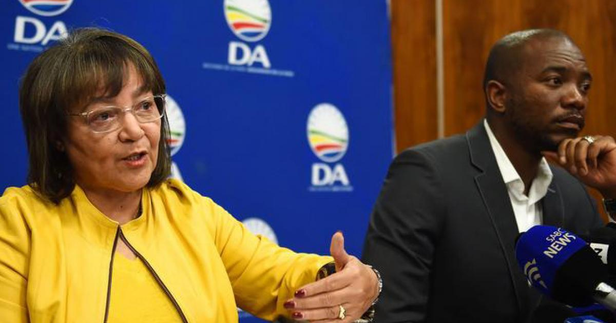 Former Cape Town mayor Patricia de Lille, alongside DA leader Mmusi Maimane, addresses the media about her exit from office in 2018.