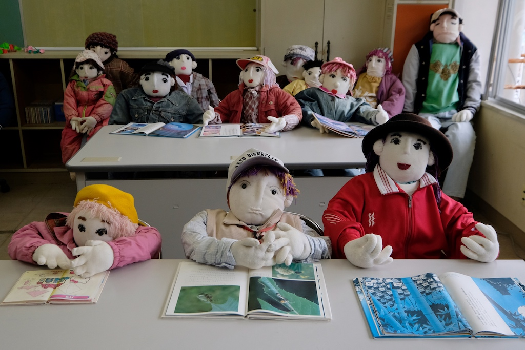 Life-size dolls depicting schoolchildren at an elementary school which closed seven years ago as there was no one left to teach.