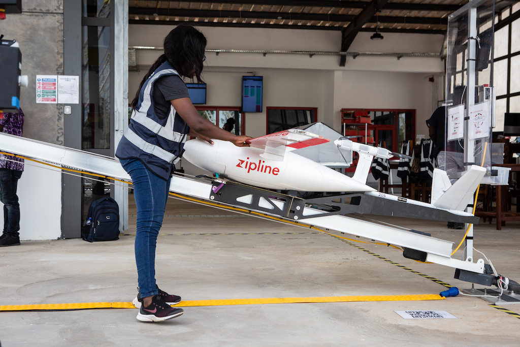 A staff member prepares a drone for the delivery of medical supplies run by operator Zipline in Ghana.