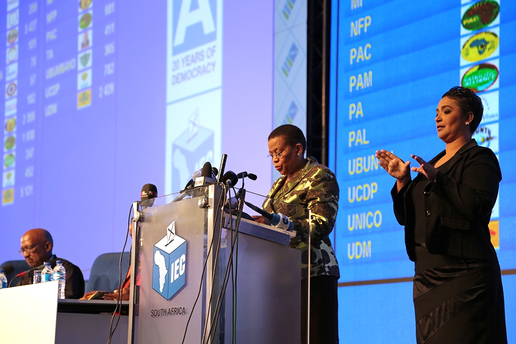 File: IEC Chairperson Pansy Tlakula, accompanied by a sign language interpreter, addresses the media at the National Results Operation Centre, in Pretoria on 8 May 2014.