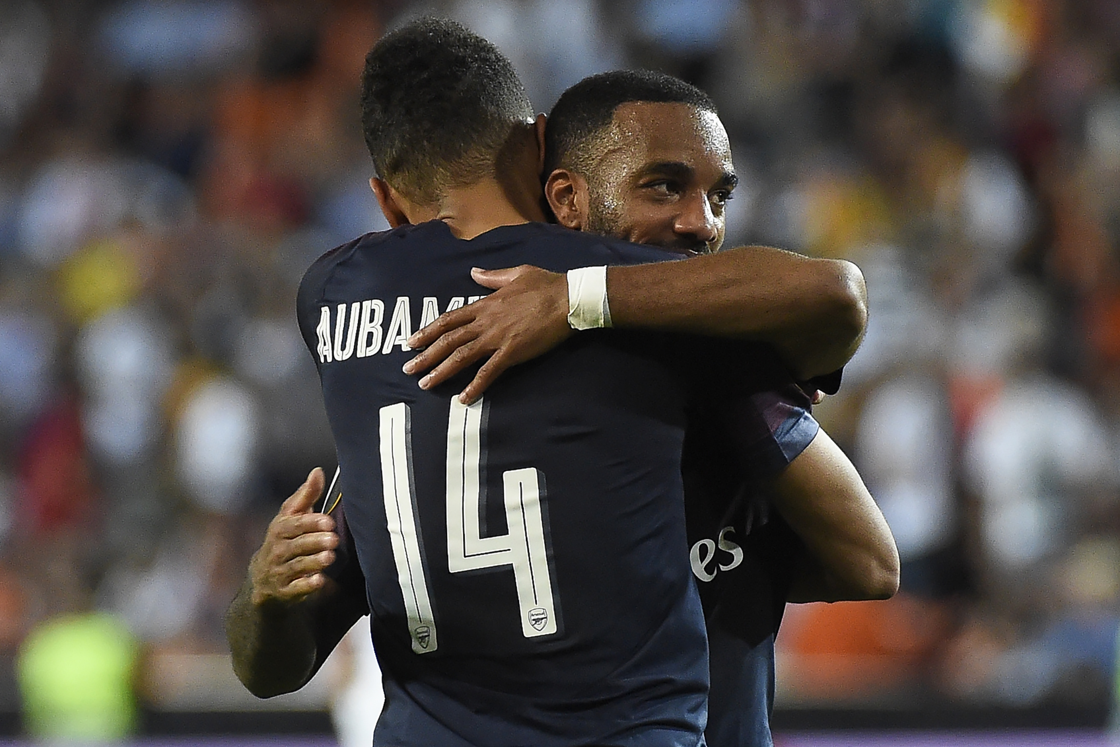 Arsenal's Gabonese striker Pierre-Emerick Aubameyang celebrates with Arsenal's French striker Alexandre Lacazette (back) at the end of the UEFA Europa League semi-final second leg football match between Valencia CF and Arsenal FC at the Mestalla stadium in Valencia on May 9, 2019.