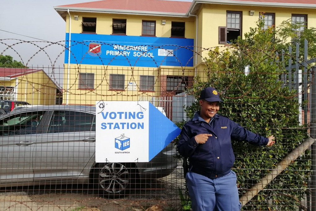 A police officer points to the voting station