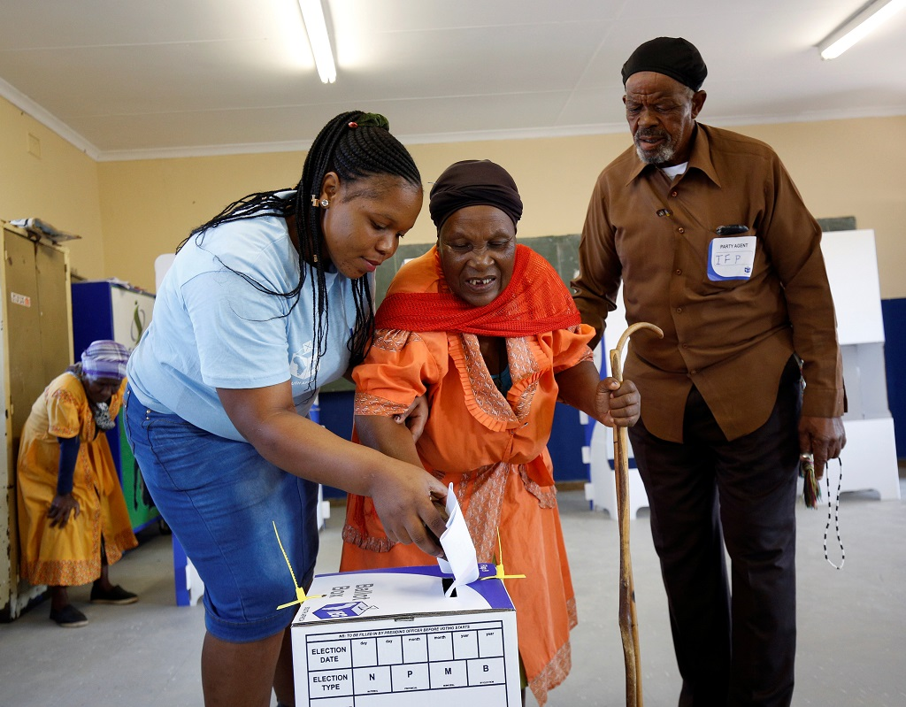 Blind voter is assisted with casting her ballot - Election 2019