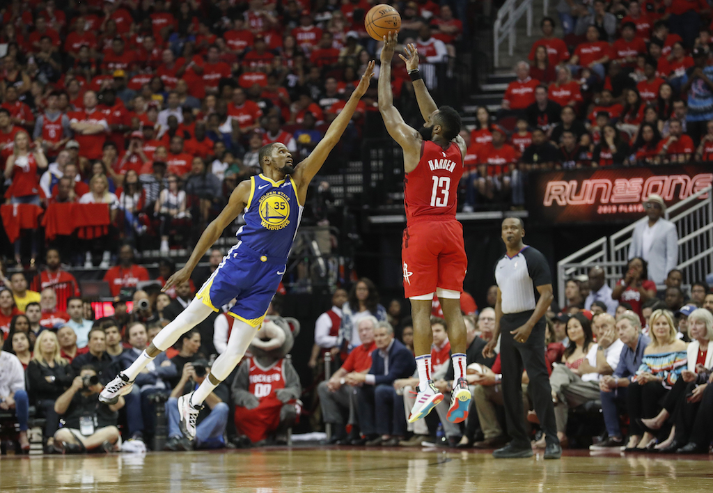 df7d6716003 James Harden  13 of the Houston Rockets takes a three point shot defended  by Kevin Durant  35 of the Golden State Warriors in the second half during  Game ...