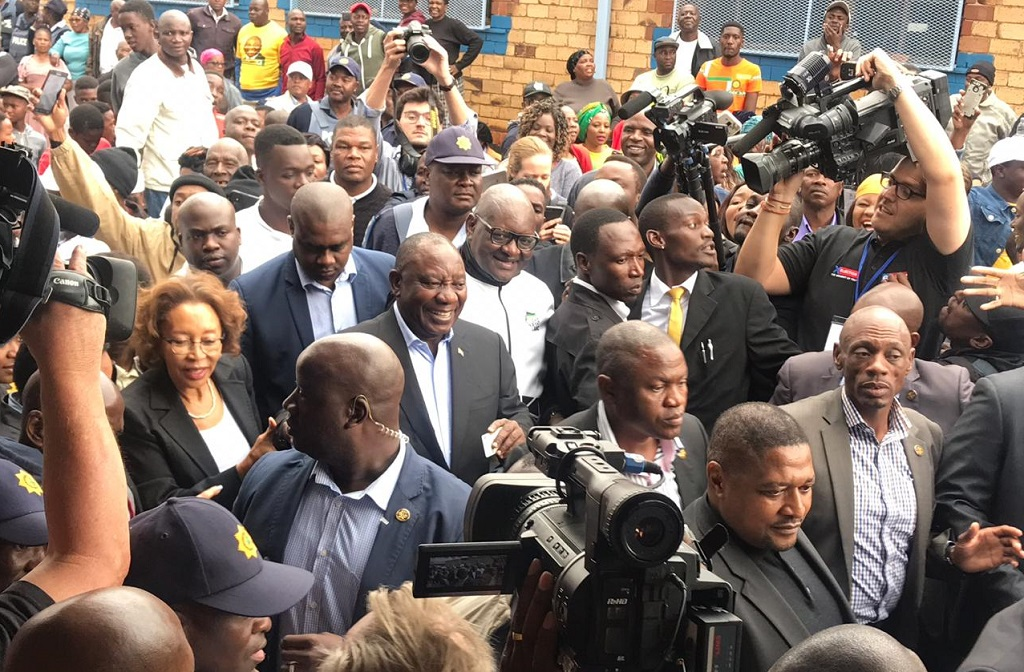 Ramaphosa surrounded by media at his voting station in Soweto