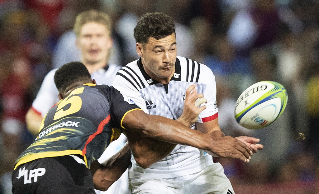 David Havili of the Crusaders (R) is tackled by Damian Willemse of the Stormers (L) during the Super Rugby match between the Crusaders of New Zealand and the Stormers of South Africa in Cape Town.