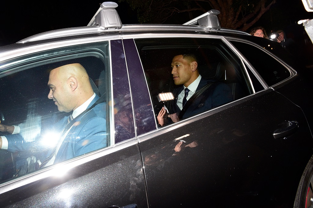 Wallabies star Israel Folau (R) leaves Rugby NSW after a Code of Conduct hearing in Sydney, Australia, 05 May 2019.