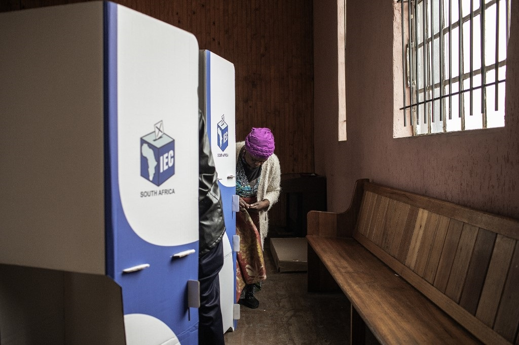 Woman marks ballot paper in election 2019