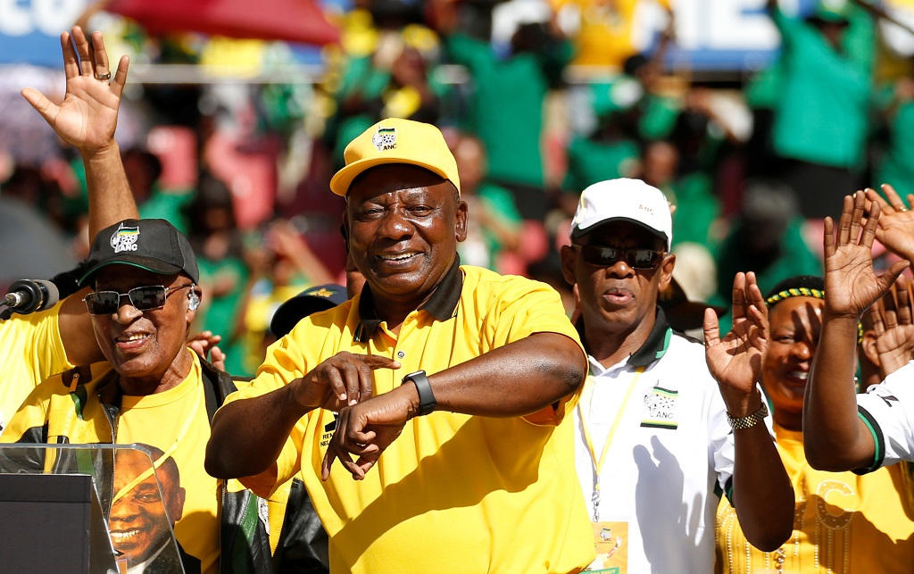 Ramaphosa points to his watch during final election rally