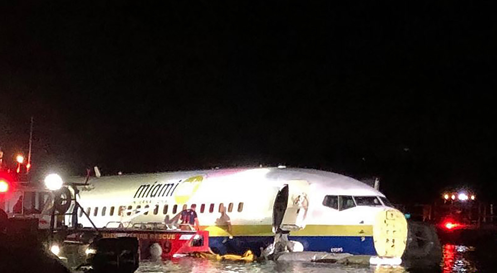 Images showed the Miami Air International plane lying partially submerged in water after the crash-landing, with its nose cone missing.