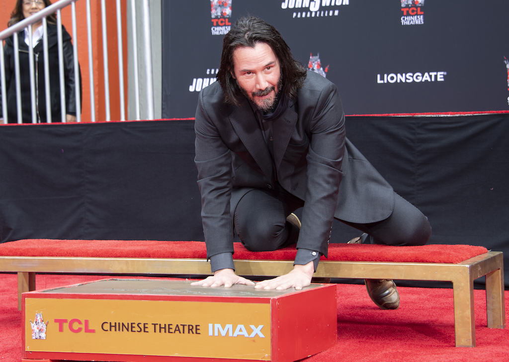 Actor Keanu Reeves places his hands in cement during his handprint ceremony at the TCL Chinese Theatre IMAX forecourt.