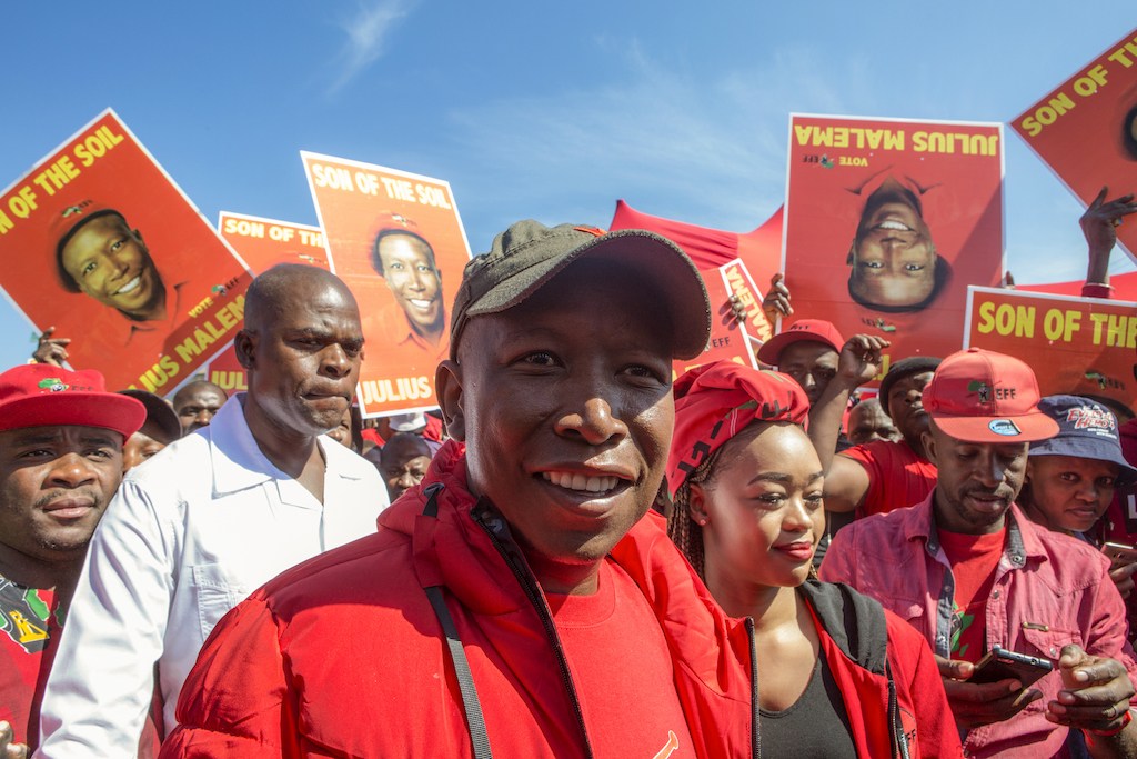 EFF leader Julius Malema surrounded by supporters.