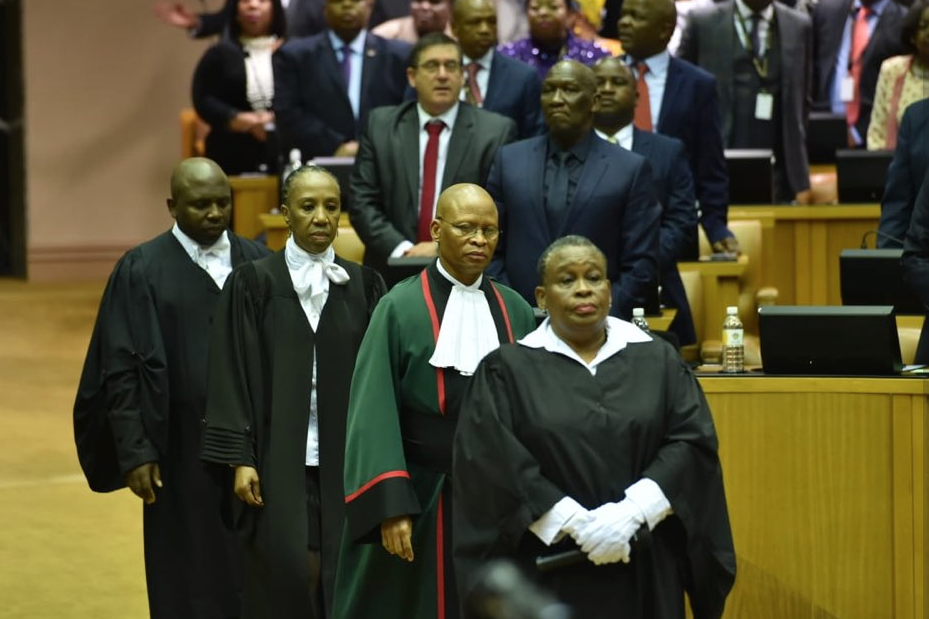Chief Justice Mogoeng Mogoeng making his way to the podium.