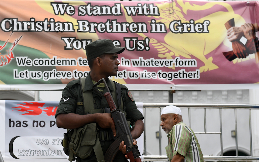 Security personnel stand guard outside a mosque during Friday prayers in Colombo.