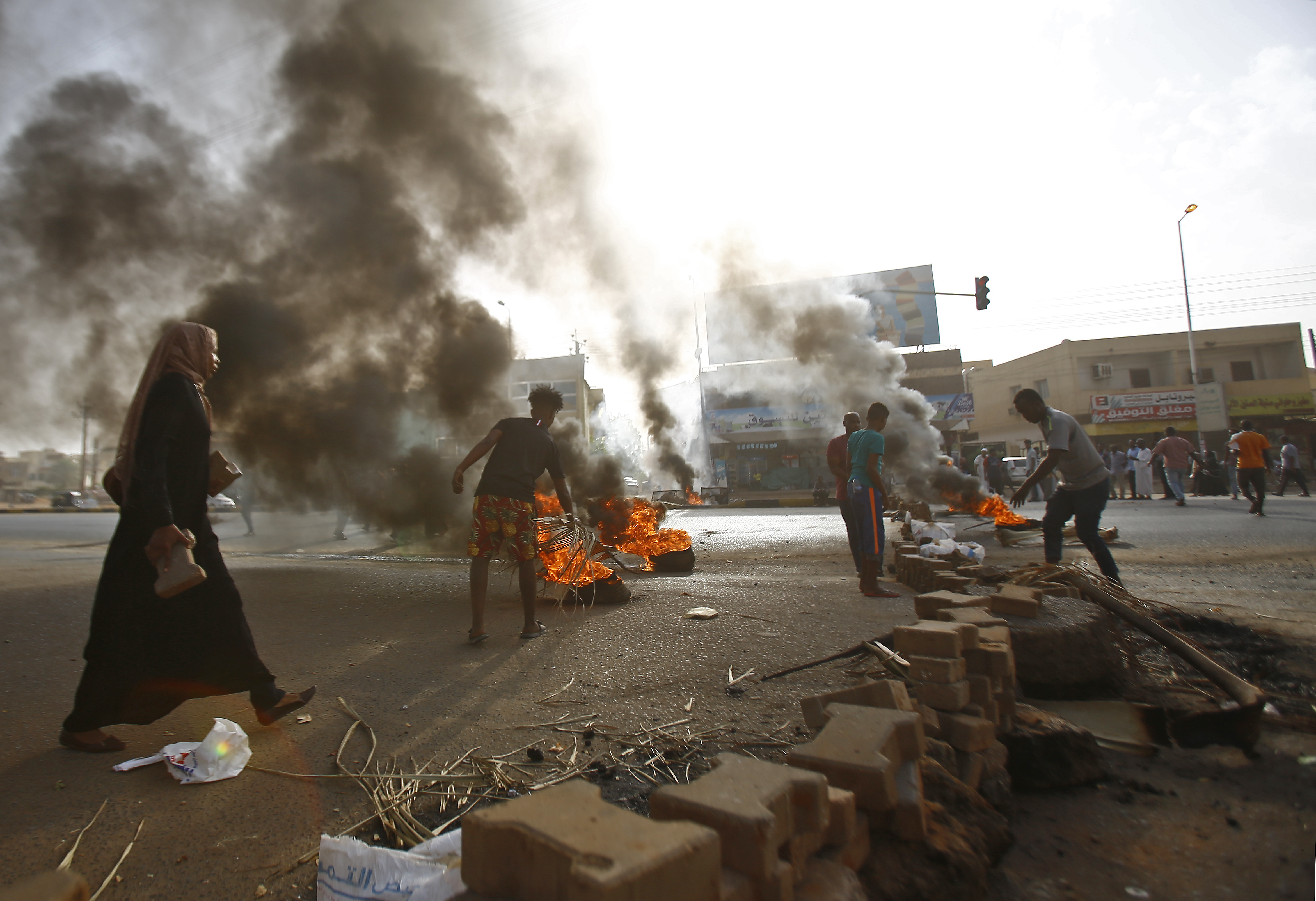 Sudanese protesters block Street 60 with burning tyres and pavers as military forces tried to disperse the sit-in outside Khartoum's army headquarters on June 3, 2019.