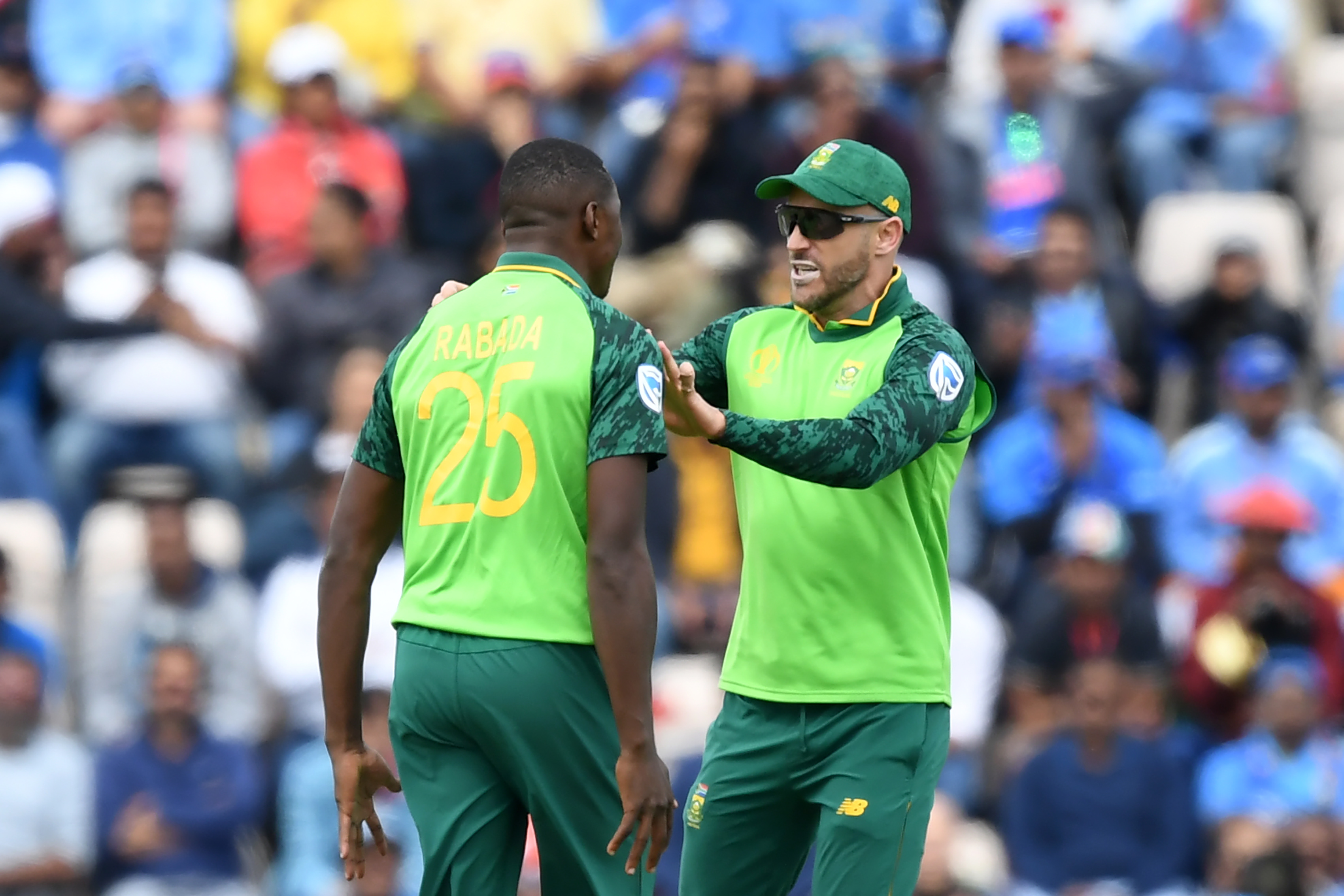 Kagiso Rabada (L) celebrates with Faf du Plessis during the 2019 Cricket World Cup group stage match at the Rose Bowl in Southampton, southern England, on 5 June 2019.