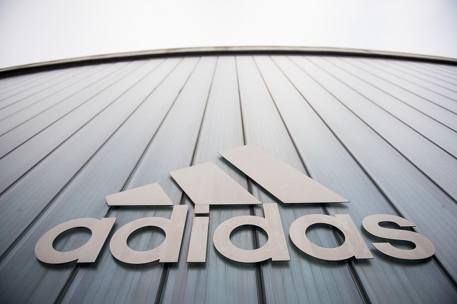 "File: Sales at the flagship Adidas brand were up four percent thanks to its ""sport-inspired"" streetwear."