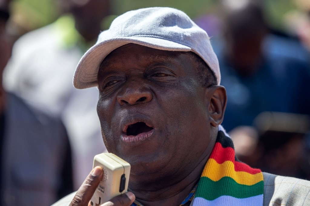 Zimbabwe's President Emmerson Mnangagwa adresses residents of Ngangu, a township of Chimanimani during his tour of the affected areas, following a devastation by cyclone Idai on March 20, 2019.