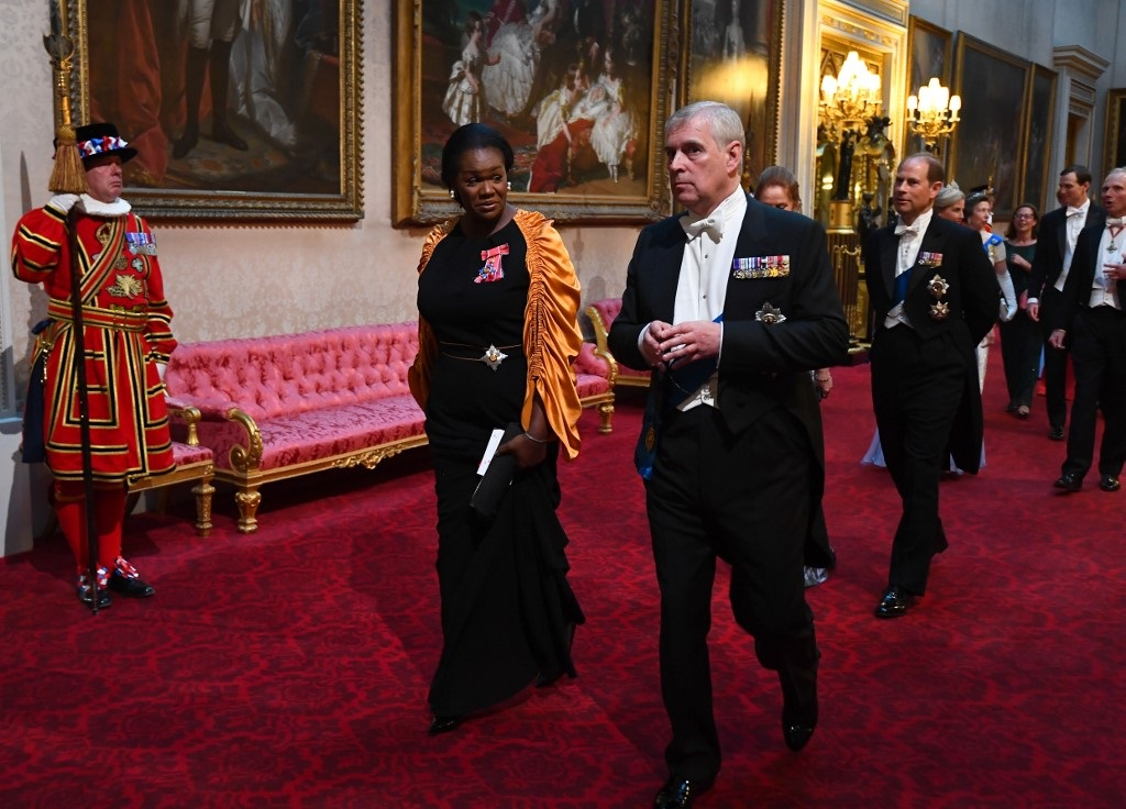 Vivien Hunt (L) and Britain's Prince Andrew, Duke of York, arrive through the East Gallery during a State Banquet in the ballroom at Buckingham Palace in central London on June 3, 2019.