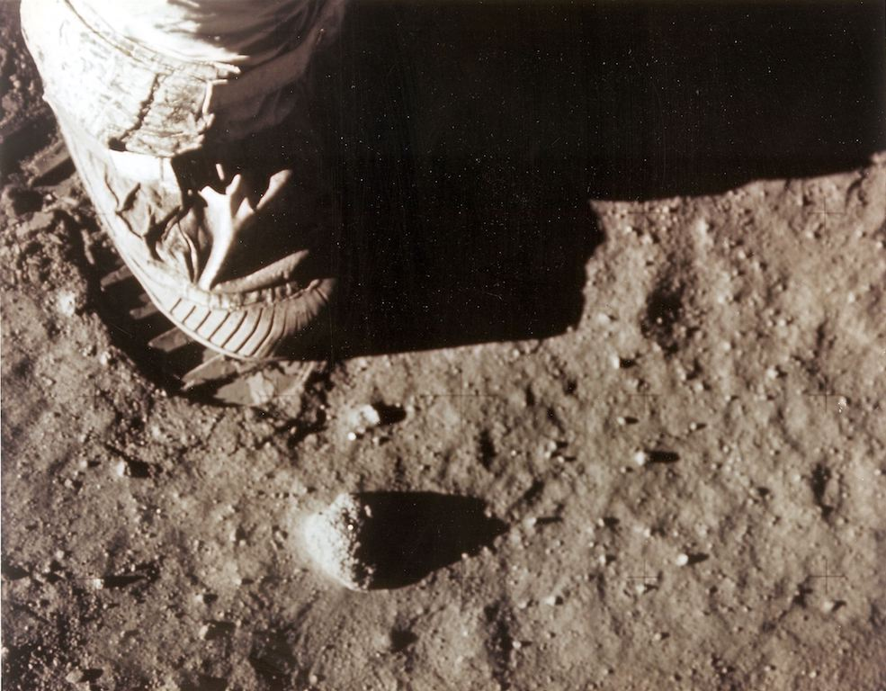 "In this photo obtained from NASA, Apollo 11 commander Neil Armstrong's right foot leaves a footprint in the lunar soil on 20 July 1969, as he and Edwin ""Buzz"" Aldrin become the first men to set foot on the surface of the moon."