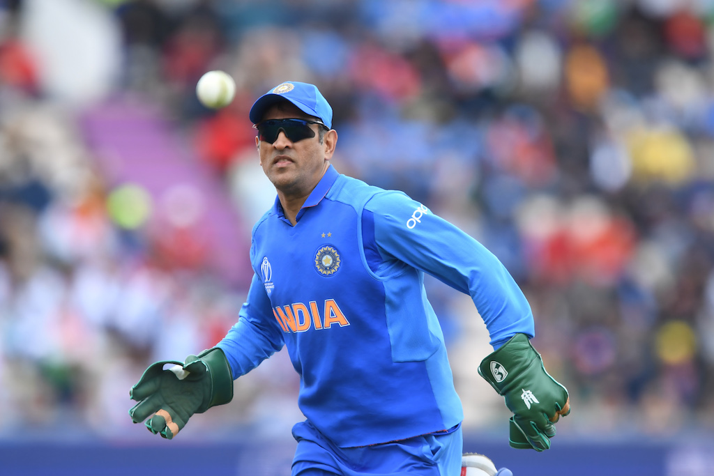 M.S. Dhoni, an honorary lieutenant colonel in India's Parachute Regiment, wore gloves featuring a dagger logo.