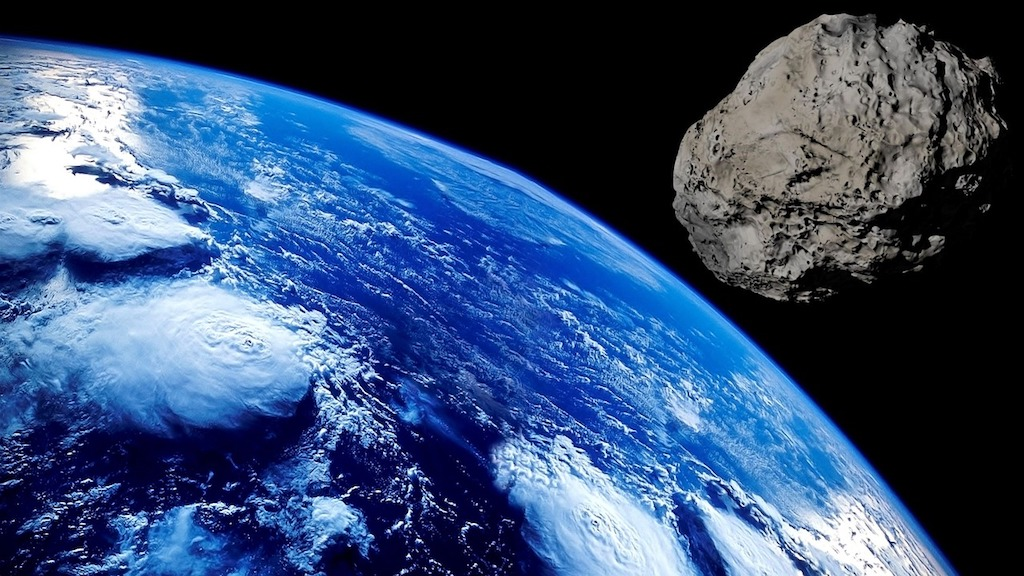 File: The Earth is pummeled with rocks incessantly as it orbits the Sun, adding around 50 tons to our planet's mass every day.