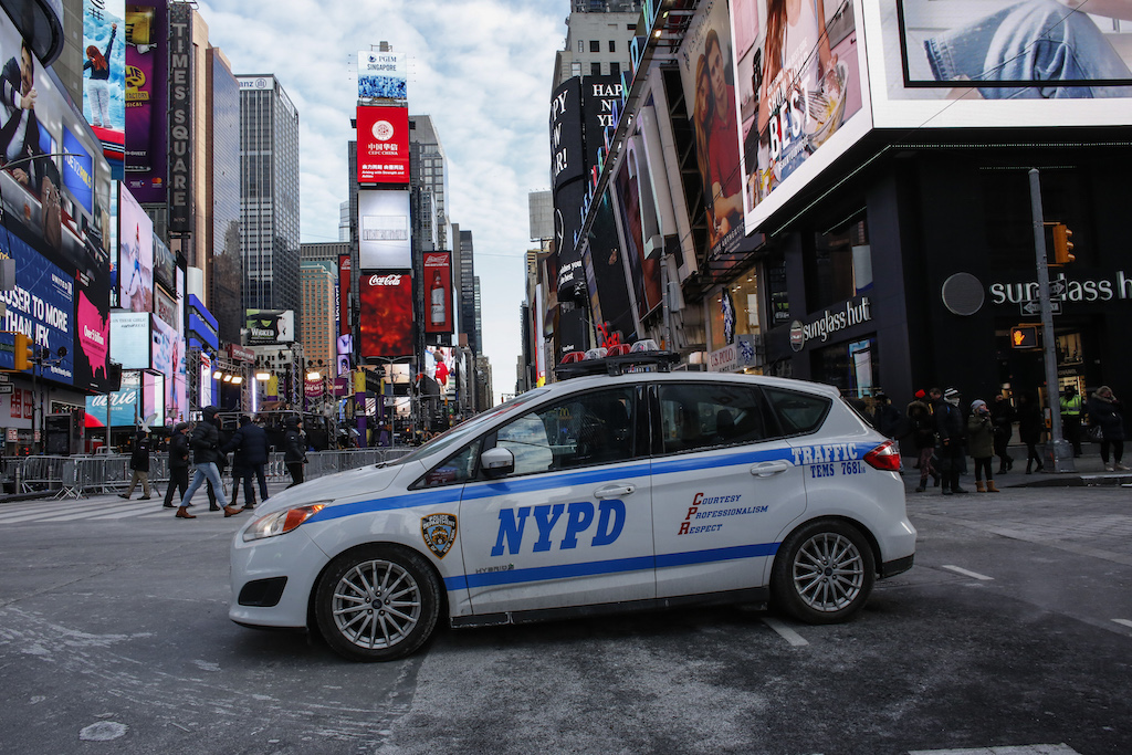 A New York Police Department (NYPD) car is parked in Times Square.