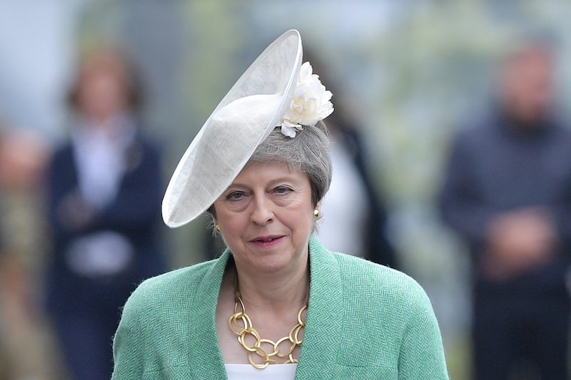 "File: Former UK Prime Minister Theresa May has described herself in interviews as a ""goody two-shoes"" whose Protestant faith defined her upbringing."