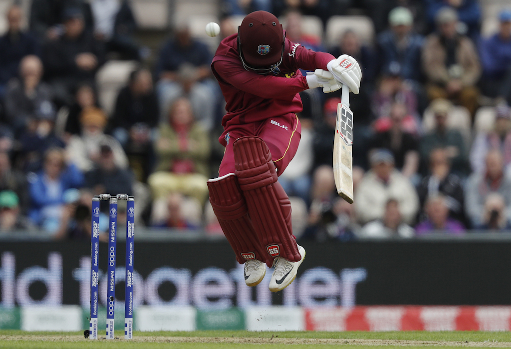 West Indies' Shai Hope leaps into the air to avoid a bouncer from England's Jofra Archer.