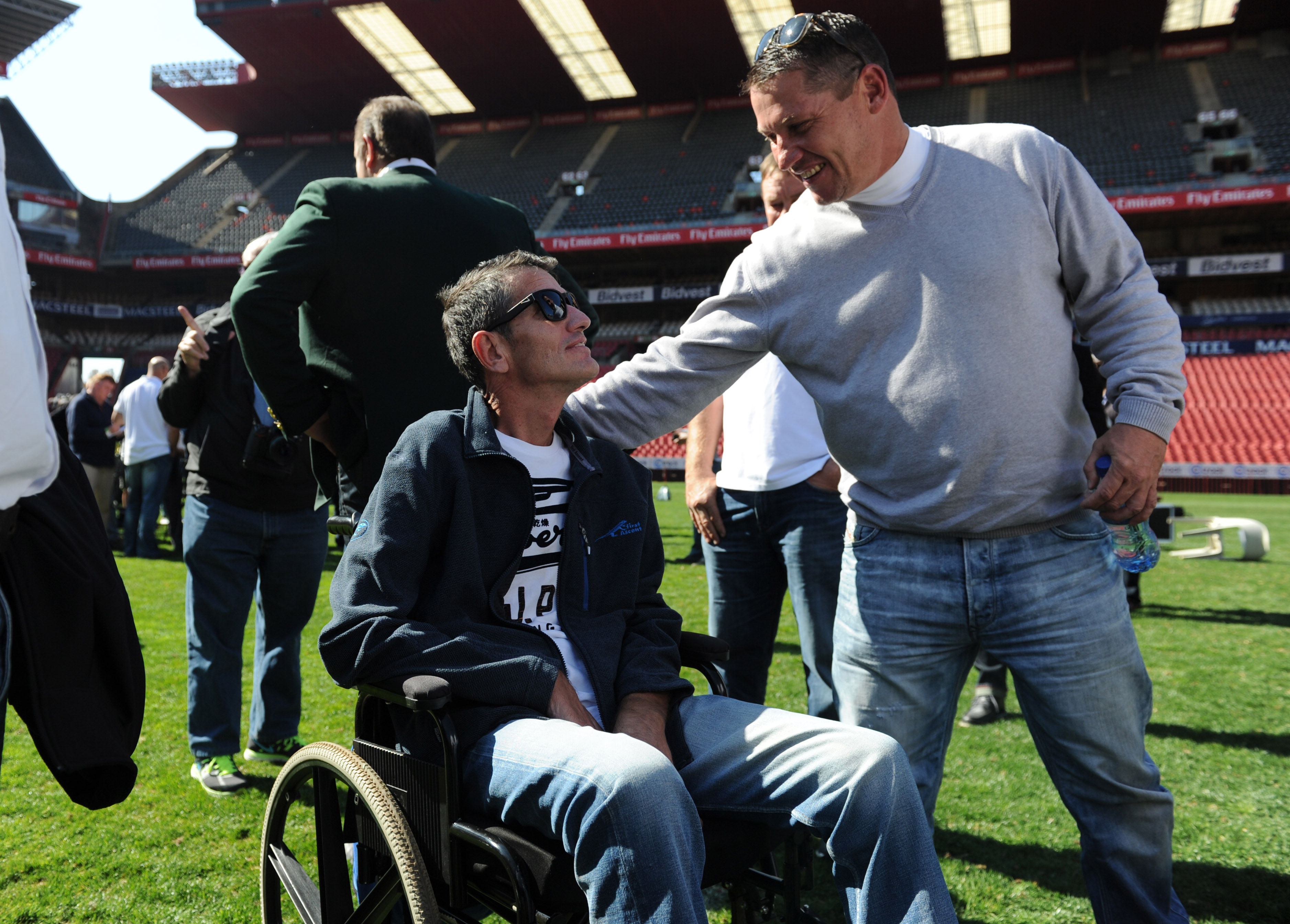 File: James Small greets Joost van der Westhuizen during an event celebrating the 20th anniversary of the epic 1995 Rugby World Cup on June 24, 2015 at Ellis Park in Johannesburg, South Africa.