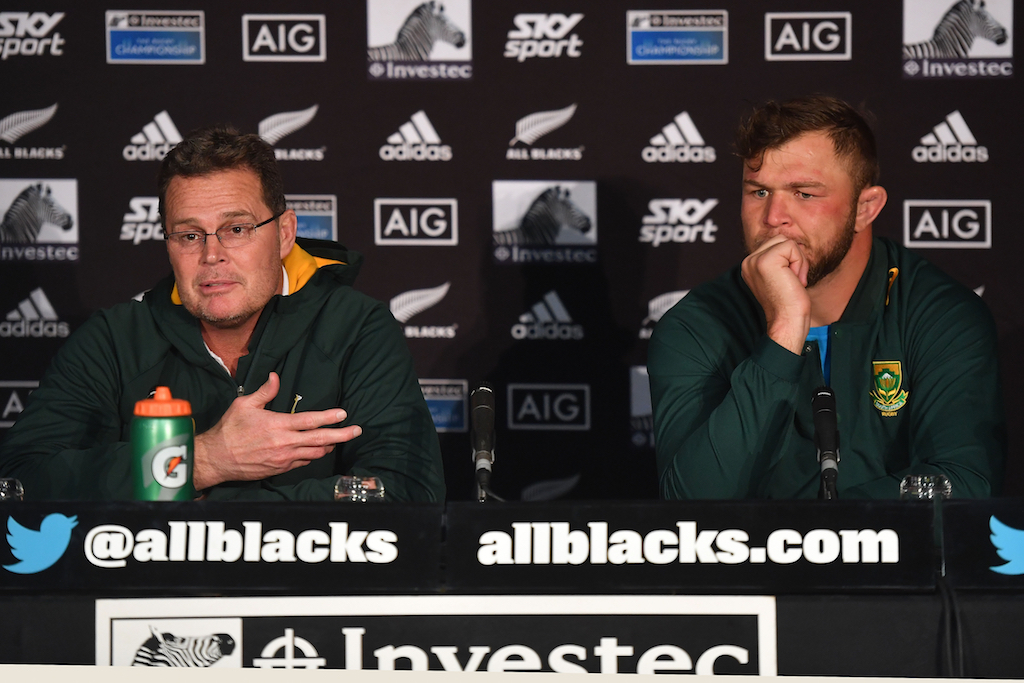 South Africa's head coach Rassie Erasmus (L) and captain Duane Vermeulen speak to the media in a post match presser after the Rugby Championship match at Westpac Stadium in Wellington on 27 July 2019.