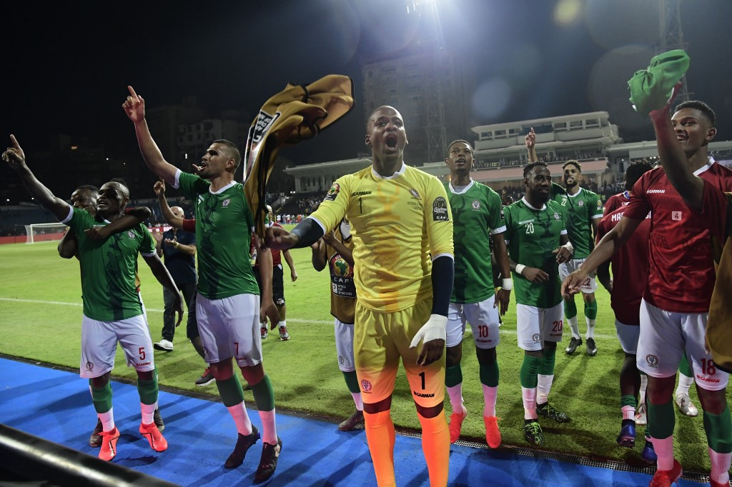 Madagascar's players celebrate their win during the 2019 Africa Cup of Nations (CAN) Round of 16 football match between Madagascar and DR Congo at the Alexandria Stadium in the Egyptian city on July 7, 2019.