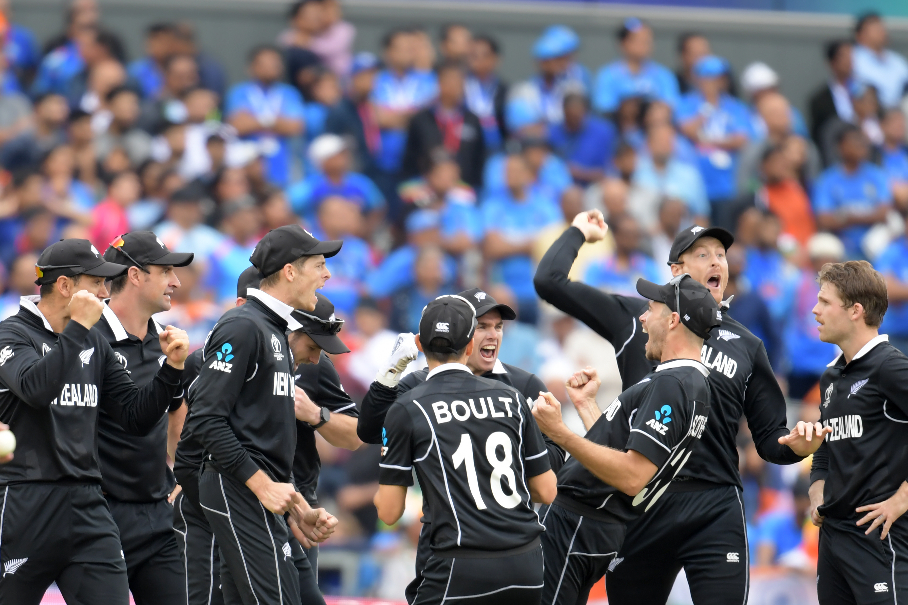New Zealand's Martin Guptill (2R) celebrates with teammates after running out India's Mahendra Singh Dhoni for 50 during the 2019 Cricket World Cup first semi-final between New Zealand and India at Old Trafford in Manchester, northwest England, on July 10, 2019.