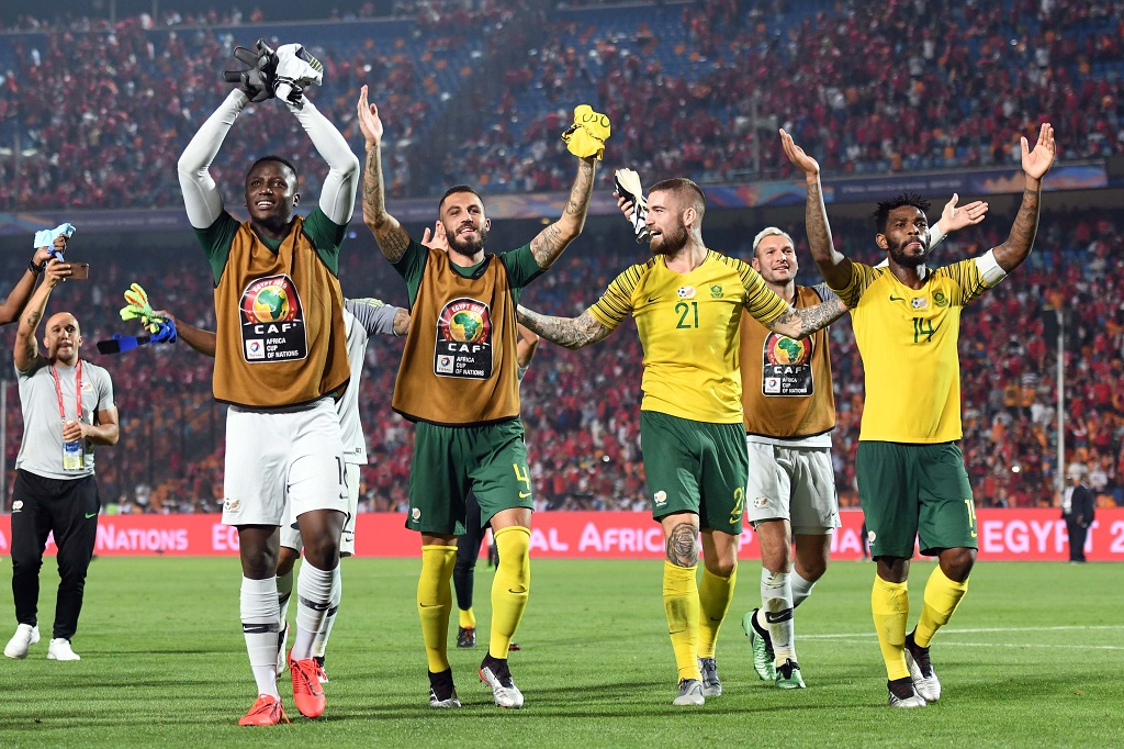 South African players celebrate after the African Cup of Nations, Last 16 match between Egypt and South Africa at Cairo International Stadium on July 06, 2019 in Cairo, Egypt.