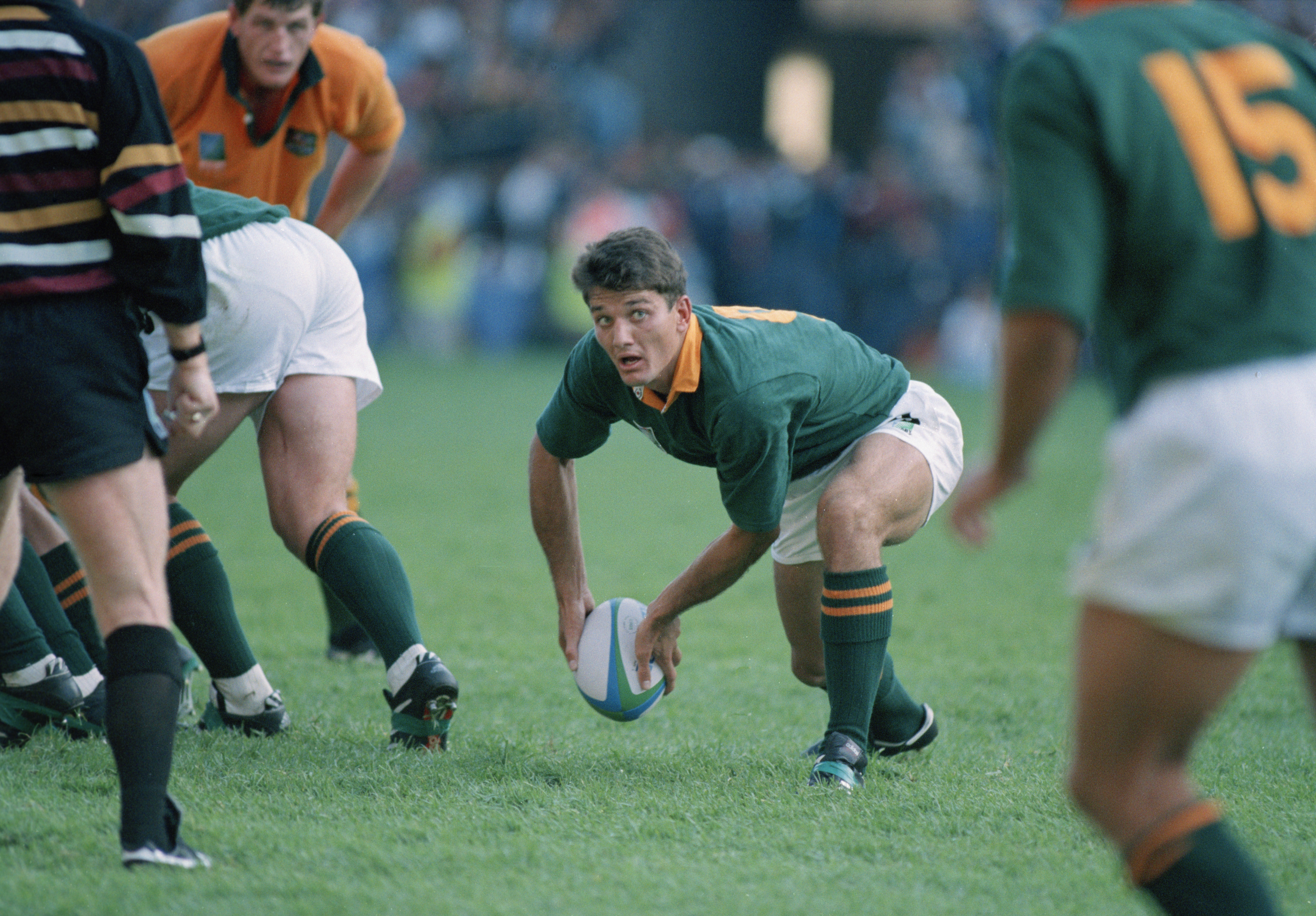 File: Joost van der Westhuizen of South Africa passes the ball during a pool stage match against Australia in the Rugby World Cup at Newlands, Cape Town, South Africa, 25th May 1995. South Africa won the match 27-18.