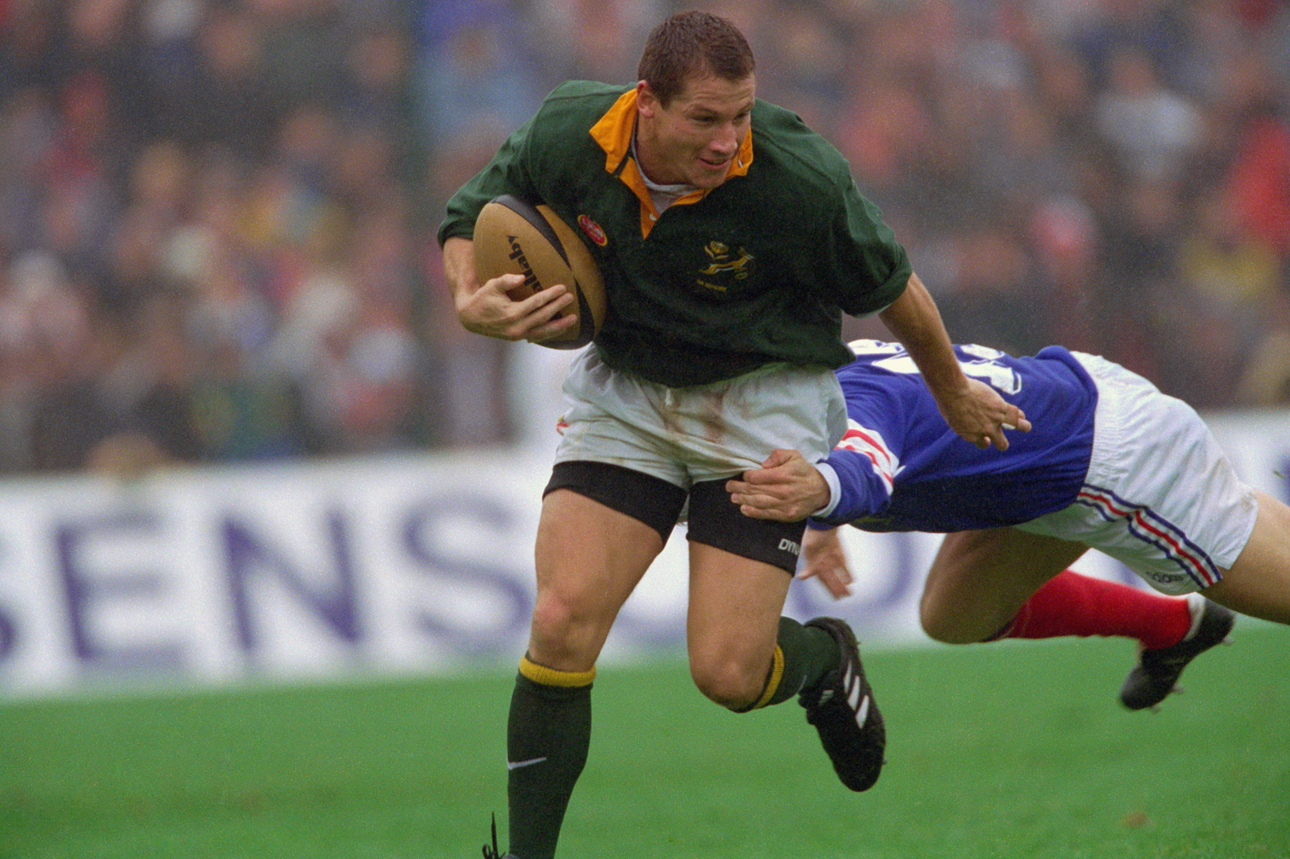 The South African wing evades a flying tackle during the first match of a test series against the French. The Springboks went on to win (22-12).