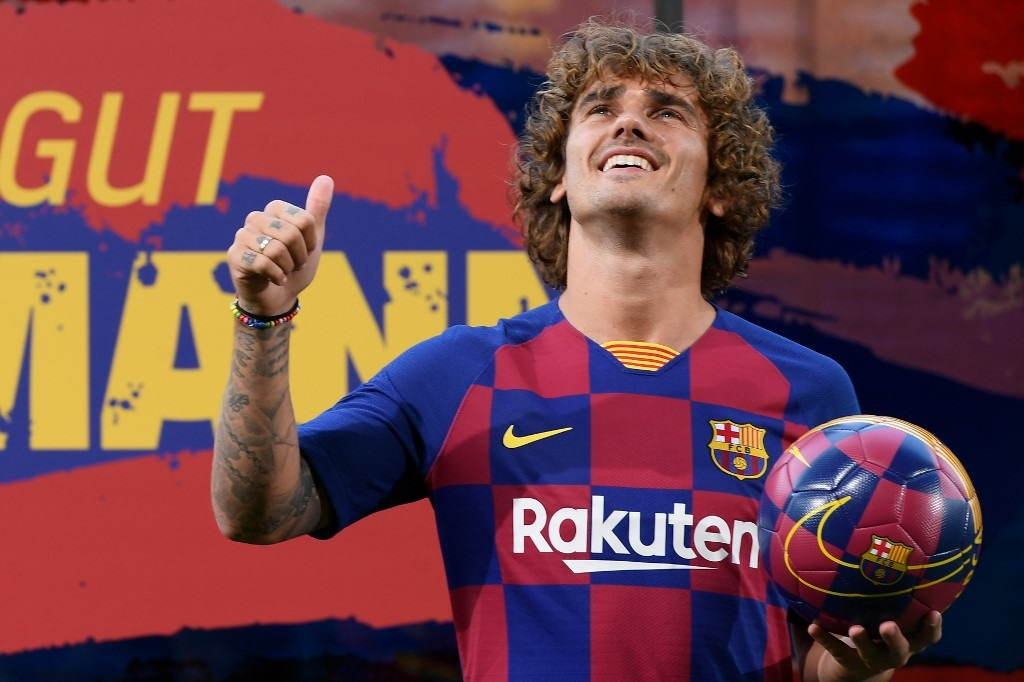 Barcelona's new French forward Antoine Griezmann poses with his new jersey during his official presentation by the Spanish football club at the Camp Nou stadium in Barcelona on July 14, 2019.