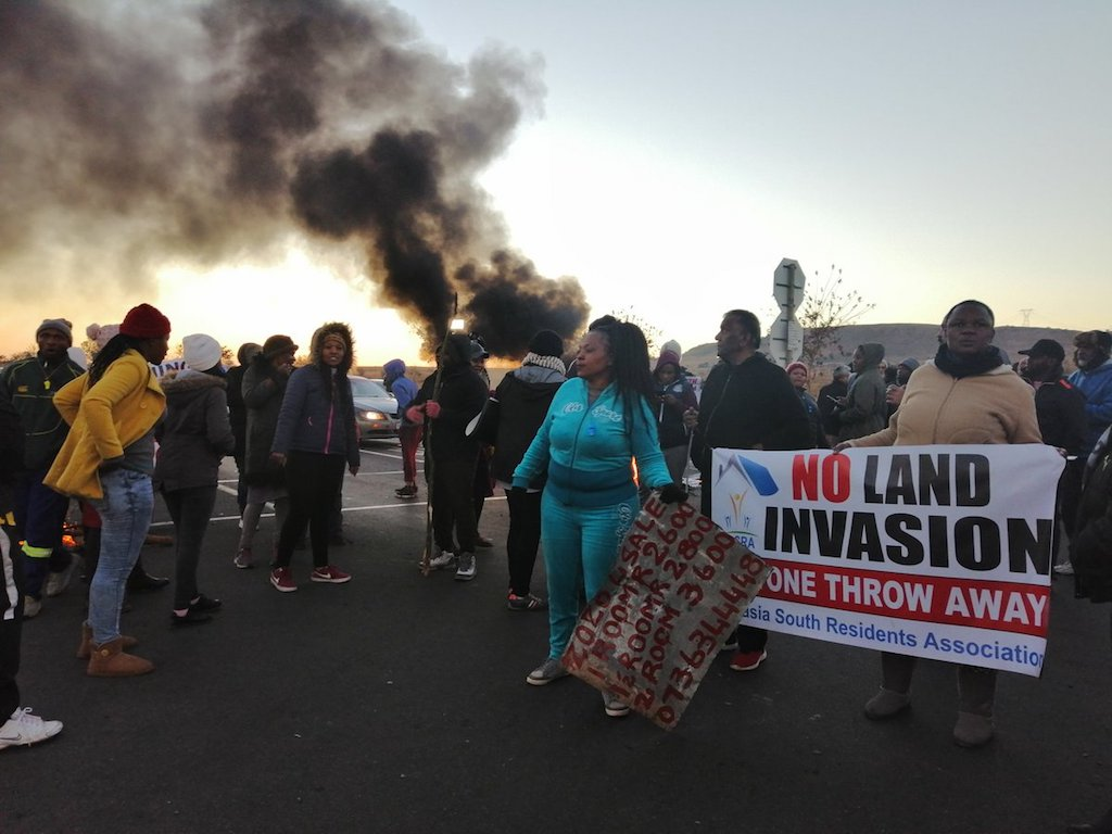 Joburg Deep South residents take to the streets to protest against illegal land invasion.