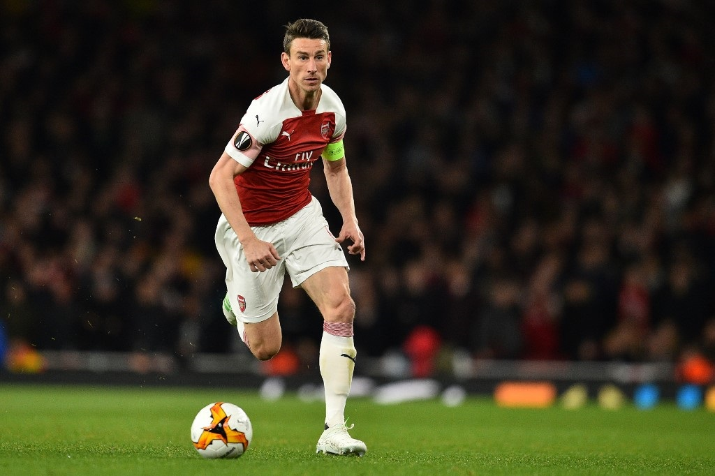 Arsenal's French defender Laurent Koscielny runs with the ball during the UEFA Europa League semi final, first leg, football match between Arsenal and Valencia at the Emirates Stadium in London.