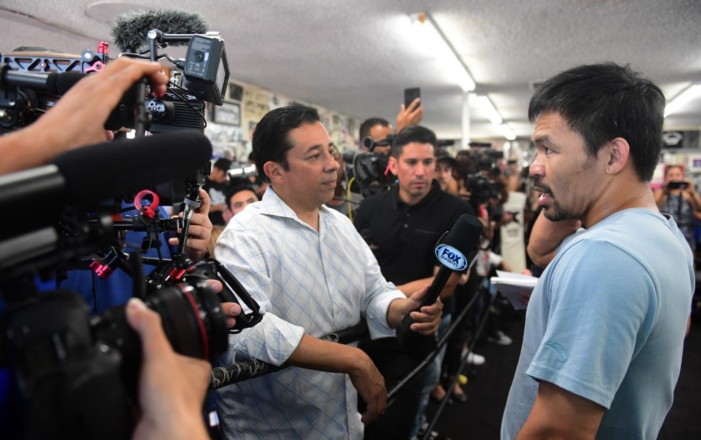 Eight-division world champion boxer Manny Pacquiao is interviewed ahead of a workout in Hollywood, California.