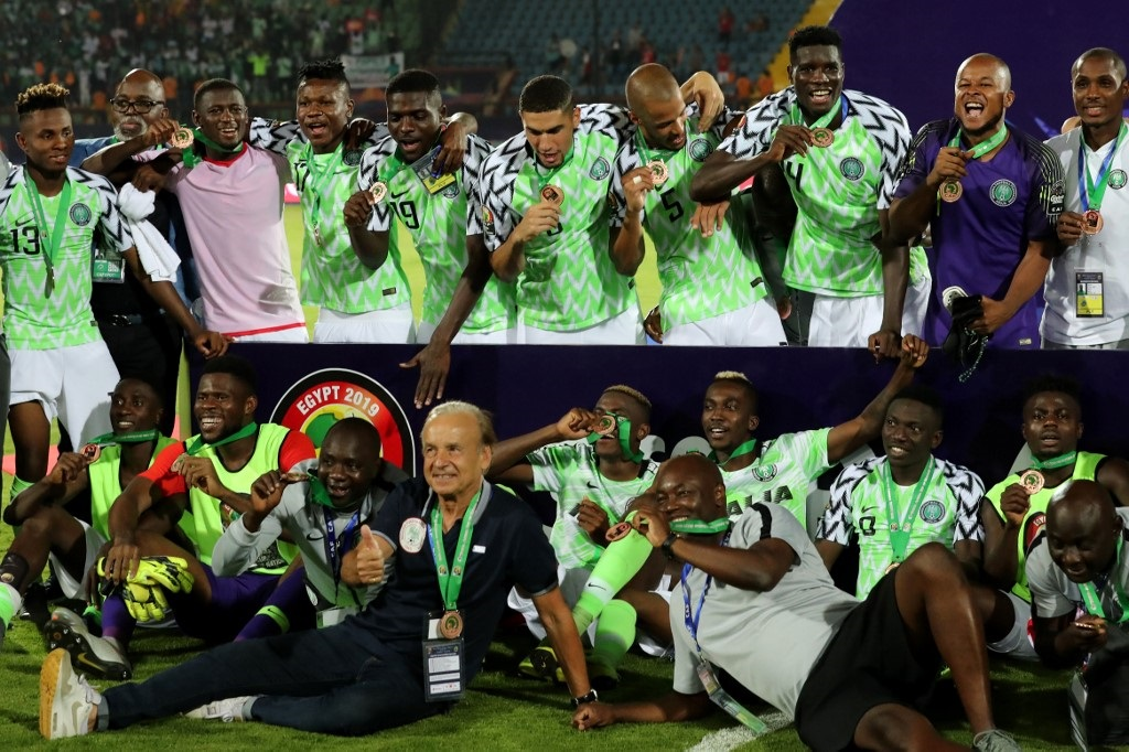 Nigerian players celebrate after winning the 2019 Africa Cup of Nations (CAN) Third place play-off football match between Tunisia and Nigeria at the Al Salam stadium in Cairo on July 17, 2019.
