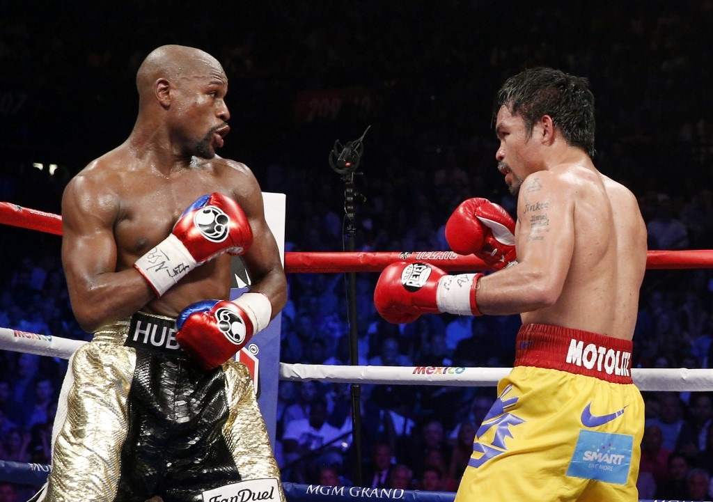 Floyd Mayweather Jr. exchange punches with Manny Pacquiao during their welterweight unification championship bout, May 2, 2015 at MGM Grand Garden Arena in Las Vegas, Nevada. Mayweather defeated Pacquiao by unanimous decision.