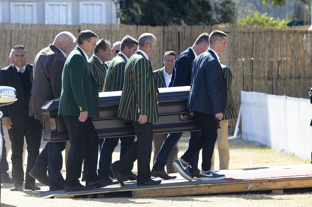 Pallbearers carry James Smalls coffin to his funeral service 18 July 2019