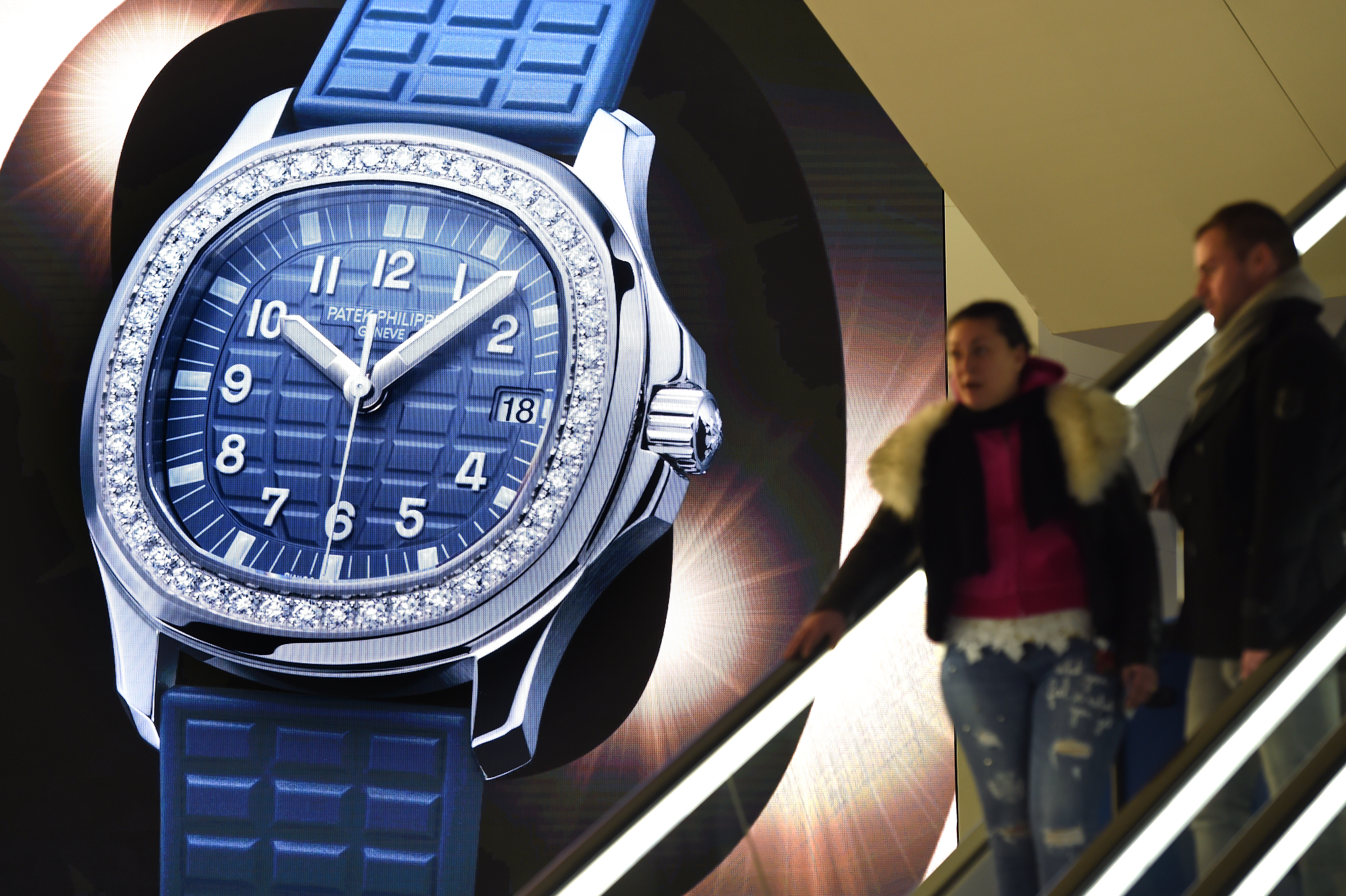 This photo taken on March 21, 2018 in Basel, Switzerland, shows a watch displayed on a giant screen at the stand of Swiss watchmaker Patek Philippe during press day, on the eve of the opening of the Baselworld watch and jewellery show.