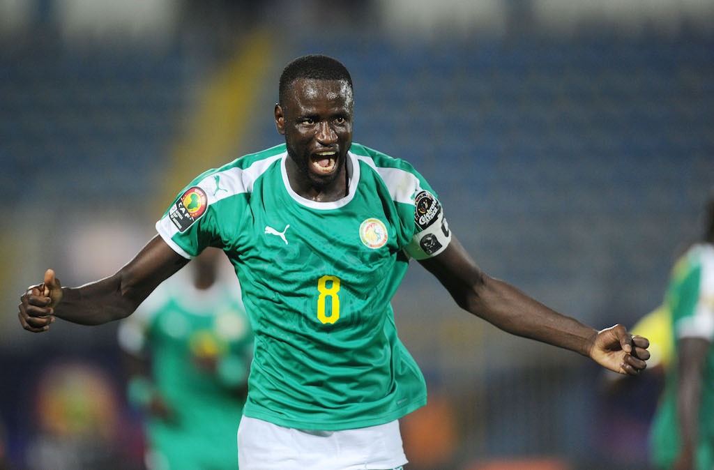 Cheikhou Kouyate of Senegal runs to celebrate after his team takes the lead in extra time during the Africa Cup of Nations 2019 Finals semifinal game between Senegal and Tunisia at 30 June Stadium in Cairo, Egypt on 14 July 2019