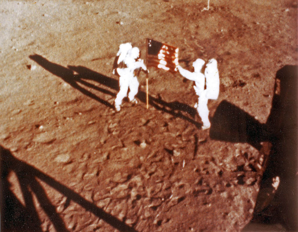 "US astronauts Neil Armstrong and ""Buzz"" Aldrin deploy the US flag on the lunar surface on 20 July 1969 during the Apollo 11 lunar landing mission."